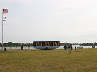 Countdown clock at KSC press site on 29 April 2011, showing a planned 2.5-hour hold at T-3 hours for Space Shuttle Endeavour's STS-134 mission.