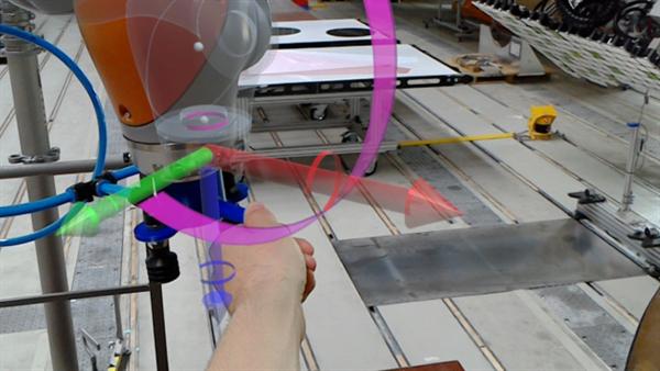 Visualisierung der Drehmomente in der HoloLens beim Handführen eines Roboters
