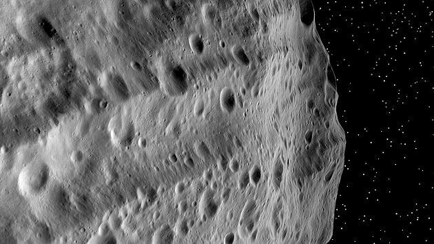 Huge troughs on Vesta – a result of mega impacts at the south pole