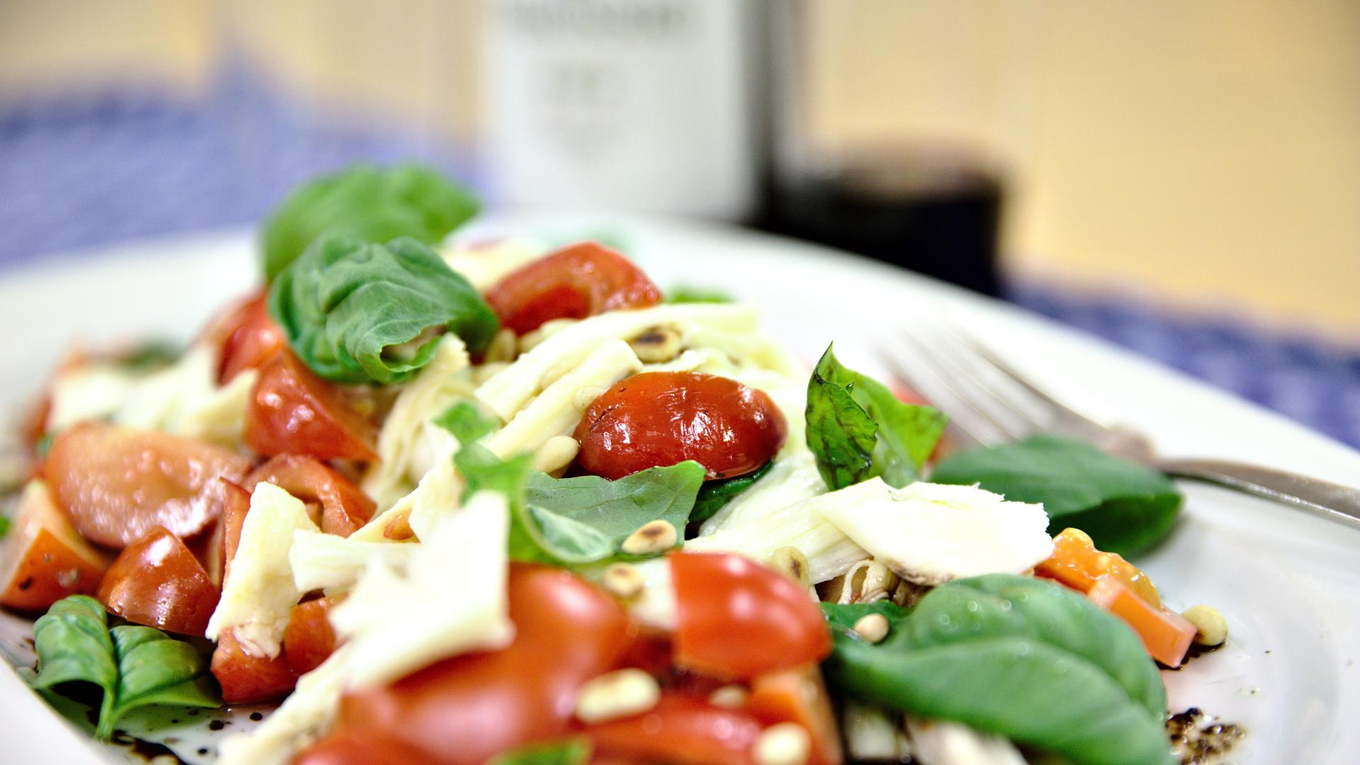 Caprese salad with tomatoes and basil from the greenhouse