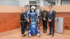 Visitors with DLR robot