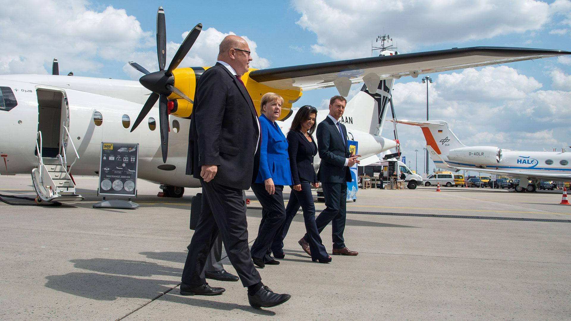 German Federal Chancellor Merkel and Economic Affairs and Energy Minister Altmaier visit the first National Aeronautics Conference