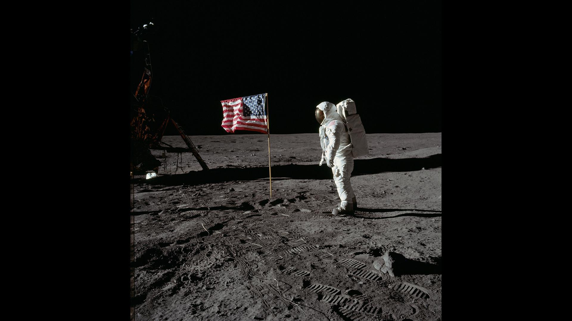Edwin 'Buzz' Aldrin salutes the Star-Spangled Banner