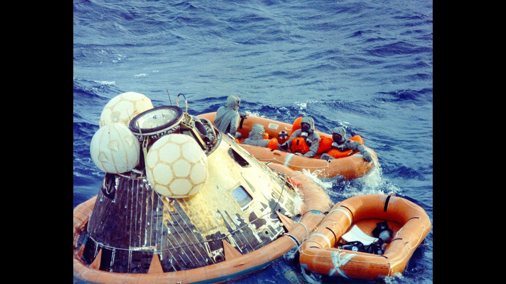 The Apollo 11 Command Module with the three astronauts on board splashed down in the western Pacific Ocean.