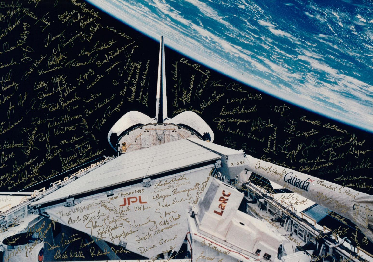 Payload bay of Space Shuttle Endeavour with the signatures of many members of the team