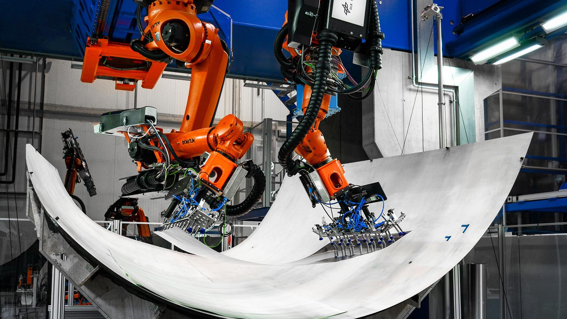 Automated handling of materials via cooperating robots