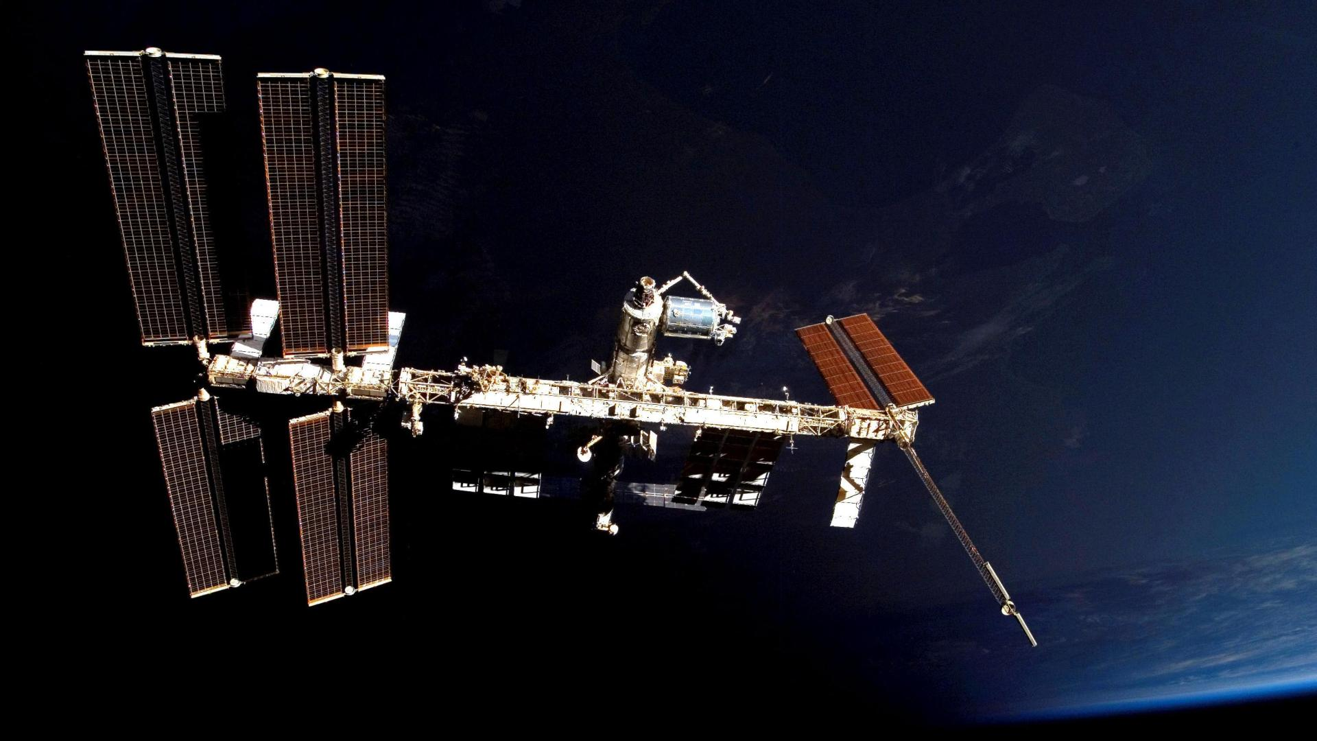 ISS and Columbus module in front of Earth
