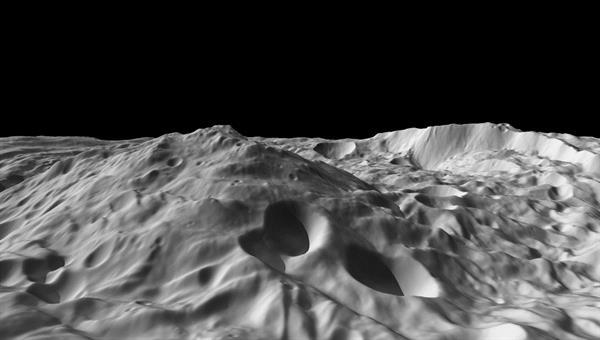 Mit 22 Kilometern fast dreimal so hoch wie der Mount Everest erhebt sich ein noch namenloser Berg inmitten eines 450 Kilometer großen Einschlagbeckens am Südpol des Asteroiden VestaQuelle: NASA/JPL%2dCaltech/UCLA/MPS/DLR/IDA