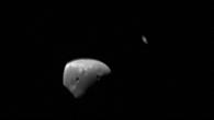 Deimos und Saturn