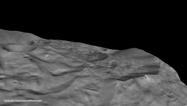 Perspective view of the rim of Vesta's south polar depression (Source: NASA/JPL%2dCaltech/UCLA/MPS/DLR/IDA.)