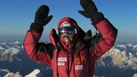 Austrian alpinist Gerlinde Kaltenbrunner cheers on reaching the summit of K2.