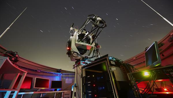 Optical Ground Station for Laser Communications with Aircrafts and Satellites