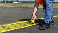 Aufbringen der Bodenmarkierungen zur Definition der Testmanöver