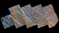 Jupitermond Europa: doppelte Bergrücken, dunkle Flecken und glatte Eisebenen