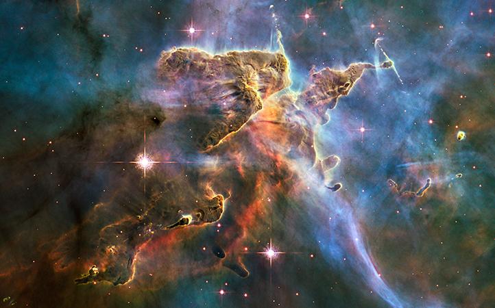Diese Aufnahme des Weltraum-Teleskops Hubble zeigt kosmische Nebel aus Gas und Staub, in denen sich neue Sterne bilden. Bild: NASA, ESA, M. Livio and the Hubble 20th Anniversary Team