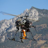 flying Helicopter with robotic arm