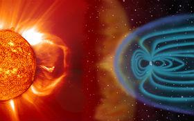 Schematische Darstellung des Auftreffens des Sonnenwinds auf das Magnetfeld der Erde mit dem teilweise bis in die Atmosphäre vordringende Teilchenschauer, der Sauerstoff- und Stickstoffmoleküle zum Leuchten anregt. Bild: NASA/ESA